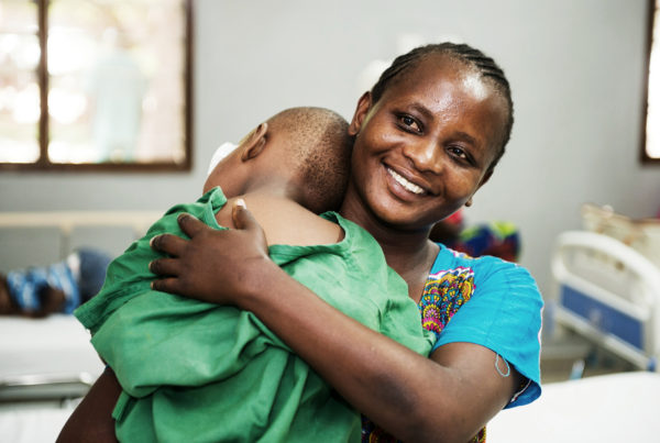 African mother holding her son